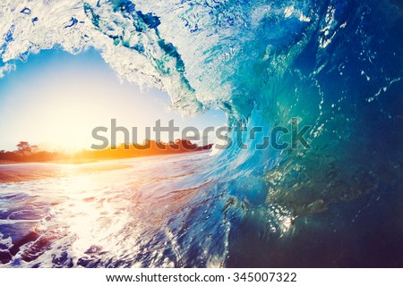 Blue Ocean Wave Crashing at Sunrise - stock photo