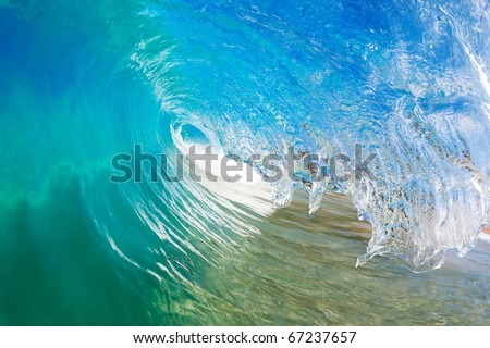 Blue Ocean Wave, View into the Tube from Water Level - stock photo
