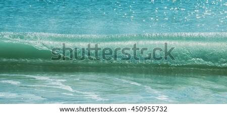 Blue ocean waves breaking on the shore of Western Australia - stock photo