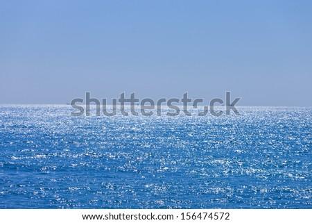 Blue ocean with horizon - stock photo