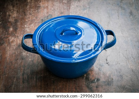 blue of cooking pot on wooden - stock photo