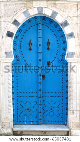 Blue old doors - symbol of Tunisia - stock photo