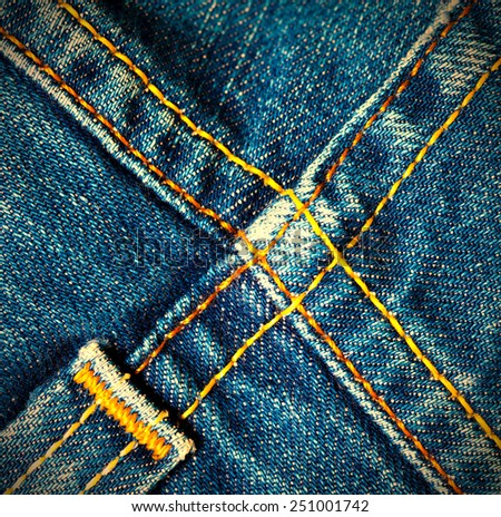 blue old jeans seams, close up - stock photo