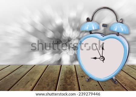 blue old retro clock on wooden floor and bokeh ,abstract background to memory of last time. - stock photo