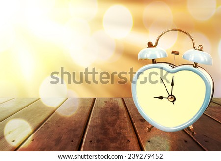 blue old retro clock on wooden floor and bokeh background ,abstract background to memory of last time.  - stock photo