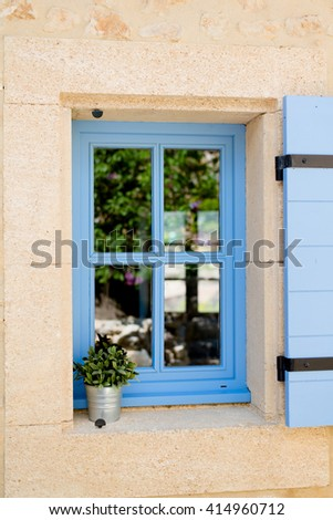 blue old window in traditional french provence architecture  - stock photo