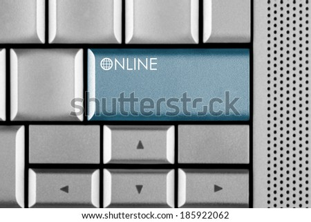 Blue ONLINE key on a computer keyboard with clipping path around the ONLINE key - stock photo