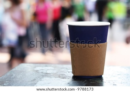 blue opened coffee cap on a street background - stock photo