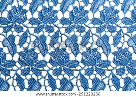 Blue openwork lace. Isolate on white. - stock photo