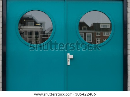 Blue outside double door  handle with lock two windows - stock photo