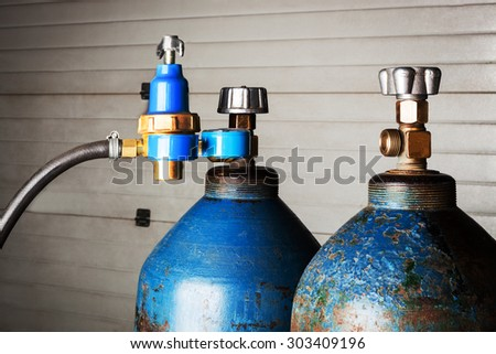blue oxygen cylinders close up - stock photo