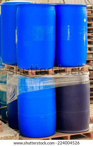 Blue packed barrels on a chemical plant - stock photo