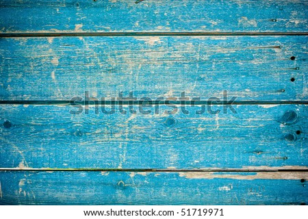 blue paint on old wooden fence - stock photo