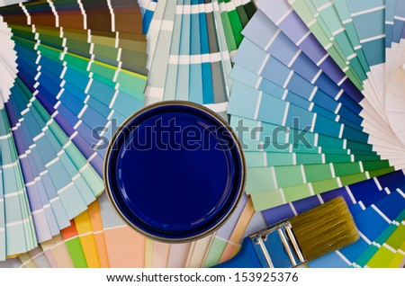 Blue paint sample. Swatches with different shades of blue and can of blue paint with brush. - stock photo