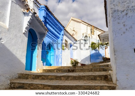 Blue painted walls of the houses in Chefchaouen, small town in northwest Morocco famous by its blue buildings - stock photo