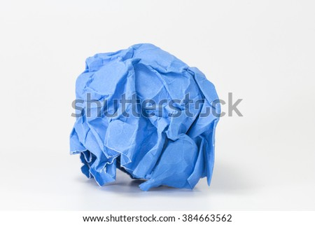blue paper balls on gray background selective focus with shallow depth of field