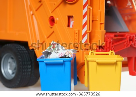 blue paper bin with paper waste in front of a garbage Truck / Paper Waste - stock photo