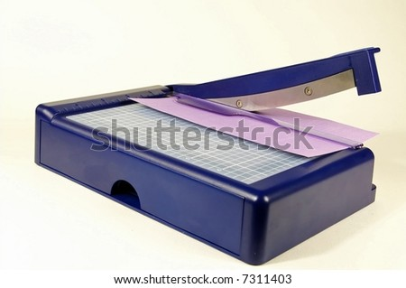 Blue paper trimmer used for scrapbooking, arts, and crafts - stock photo