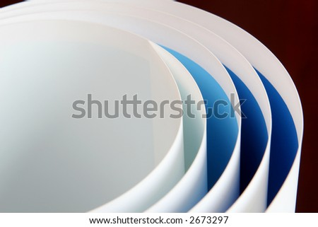 Blue papers from light to deep curved some arcs - stock photo