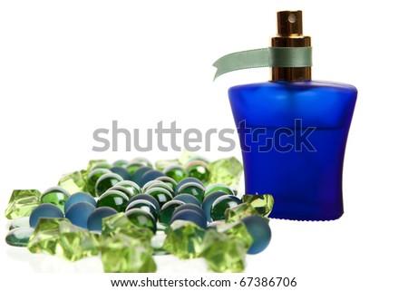 Blue parfume bottle on white background back lit - stock photo