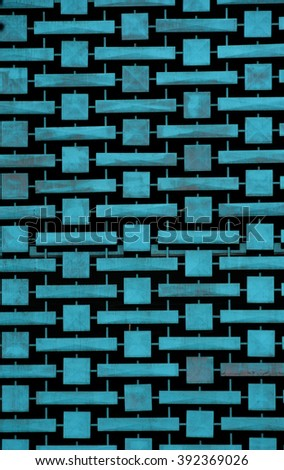 blue patterned ornament on a parking garage - stock photo