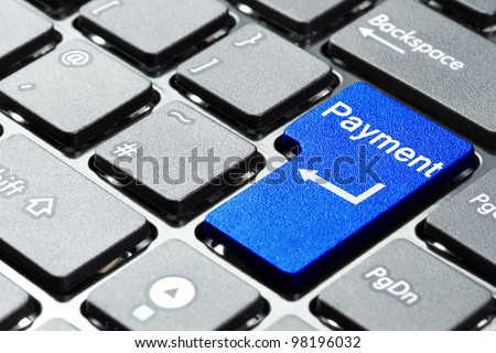 Blue payment button on the keyboard - stock photo