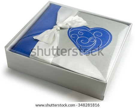 Blue photo album with heart in gift box isolated on white background. Present of Valentines Day - stock photo
