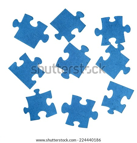 Blue pieces of jigsaw puzzle isolated over white