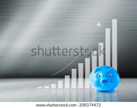 Blue piggy bank and growth graph - stock photo