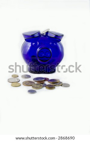 Blue piggy bank and scattered coins