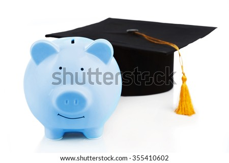 Blue piggy bank with Graduation hat isolated on white