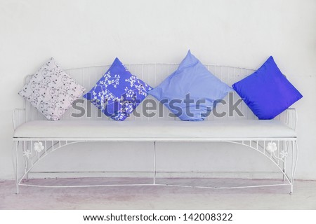 Blue pillow on the white chair. - stock photo