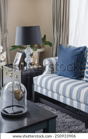 blue pillows on sofa with black lamp in living room at home - stock photo