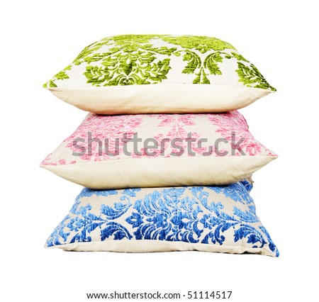 Blue, pink and green cushion stacked up on a pure white background with space for text - stock photo