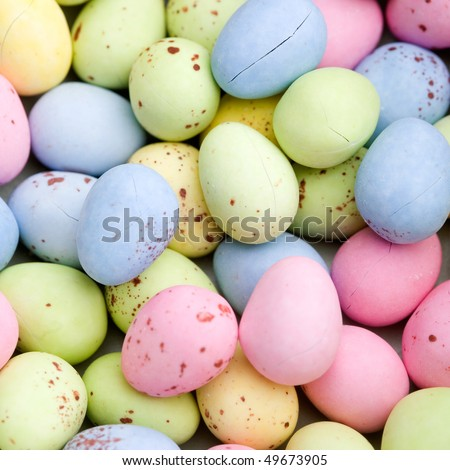 Blue, pink, yellow and green chocolate easter eggs - stock photo