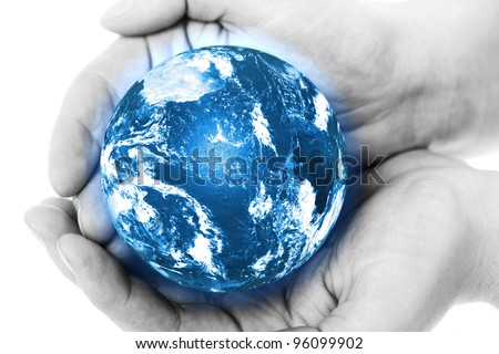 Blue planet in human hands - stock photo