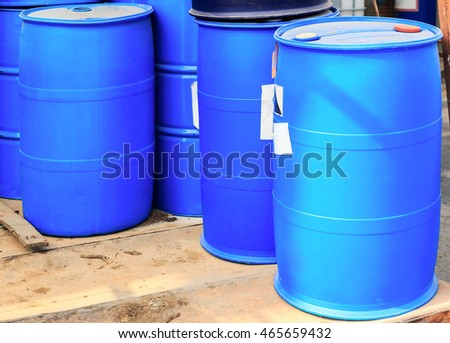 Blue plastic barrels in a chemical plant