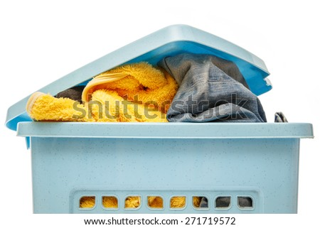 Blue plastic basket full of clothes for washing - stock photo