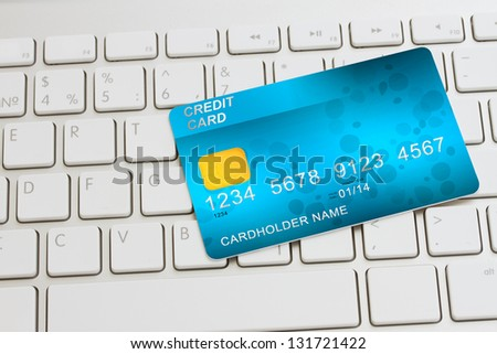 blue  plastic card  on modern keyboard - internet shopping concept - stock photo