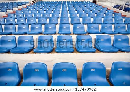 Blue plastic chair in stadium - stock photo