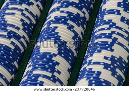 Blue Poker Chips in a Row - stock photo