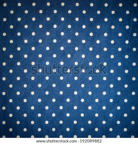 Blue polka dot fabric background - stock photo