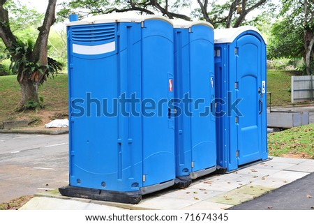 Blue Portable Toilets Installation In The Park - stock photo