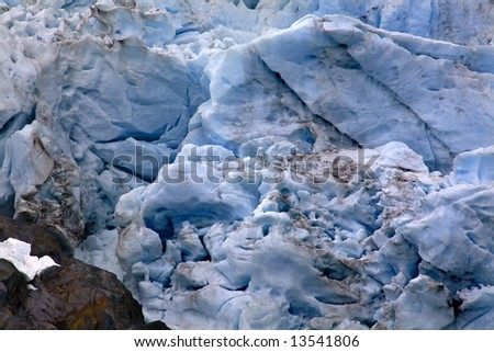 Blue Portages Glacier with Colored Rock Close Up, Anchorage, Alaska - stock photo