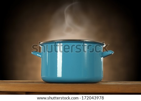 blue pot and smoke on brown background