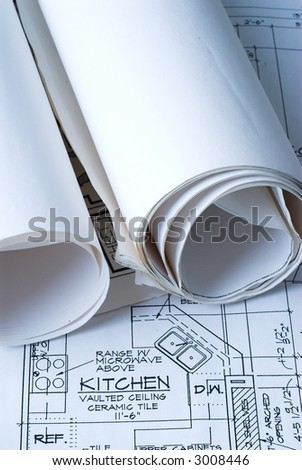 Blue Prints on a Work Table - stock photo