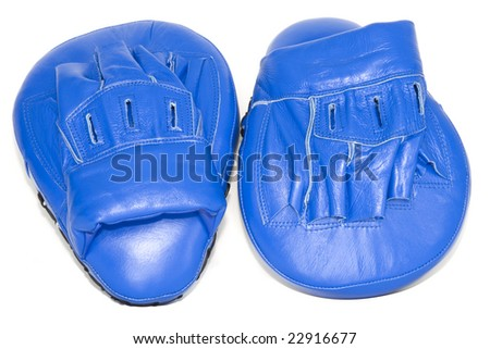 Blue punching focus mitts isolated with clipping path - stock photo