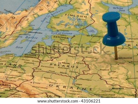 Blue push pin in a map, indicating the position of Moscow, Russia - stock photo