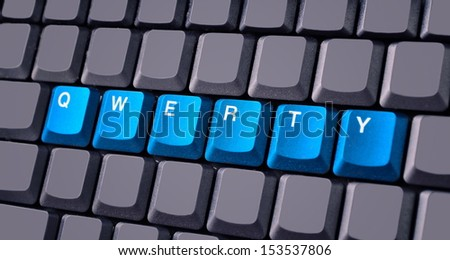 Blue qwerty button on keyboard