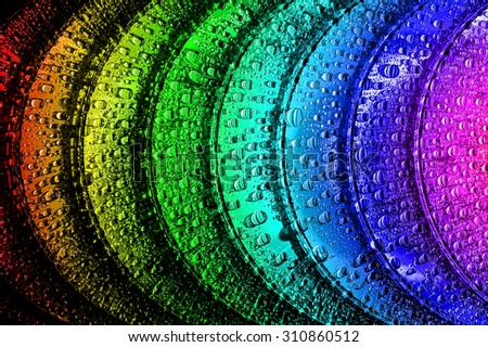 Blue-ray, DVD or CD disc with drop colour background - stock photo